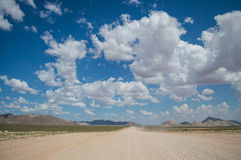 Scenic View of a Desert and Mountain Landscape with Road Royalty Free Stock Photos