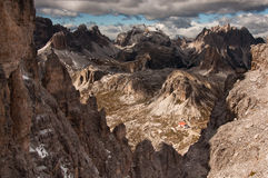 Scenic view of Dolomites mountain range. On cloudy day with Locatelli refuge in the valley Stock Photo