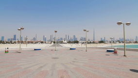 Scenic view of the Dubai skyline from beach stock video footage