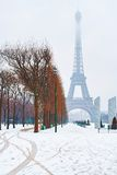 Scenic view of the Eiffel tower on a snowy winter day Stock Photos