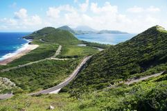 Scenic view from elevated overlook towards St. Kitts isthmus and Nevis Island, St. Kitts Stock Image