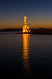 Scenic view of the entrance to Chania harbor with lighthouse at sunset, Crete Royalty Free Stock Photography