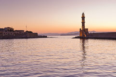 Scenic view of the entrance to Chania harbor with lighthouse at sunset, Crete Royalty Free Stock Photos