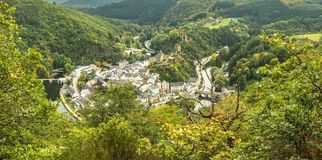 Scenic view of Esch sur sure town in Luxembourg in summer. Beautiful old town of Esch sur Sure hidden in the Ardennes forest on the Sure river bank meandering Royalty Free Stock Photos