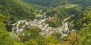 Scenic view of Esch sur sure town in Luxembourg in summer. Beautiful old town of Esch sur Sure hidden in the Ardennes forest on the Sure river bank meandering Royalty Free Stock Image