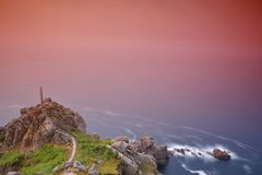 Scenic view of exposed seascape with cliff stock photography