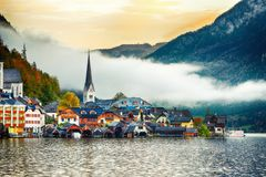 Scenic view of famous Hallstatt mountain village with Hallstatter lake. Foggy autumn sunrise on Hallstatt lake royalty free stock photography