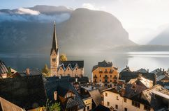 Scenic Hallstatt town in morning, Austria. Scenic view of famous Hallstatt town on Hallstattersee lake in the Austrian Alps in morning light with bright clouds Stock Photography