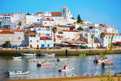 Scenic view of fishing boats in Ferragudo, Portugal Stock Photo