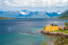 Scenic view of fjord, snow mountains and house, Stock Photos