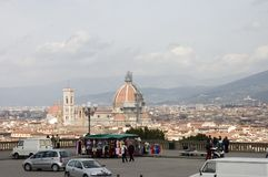 Scenic view of Florence city. People admiring the Florence city from piazza Michelangelo, Florence, Tuscany. View on the Duomo,the Cathedral, the colored houses royalty free stock photography