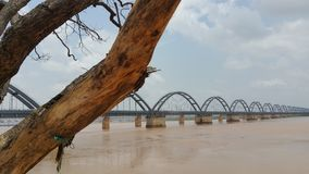 Scenic wide view of arch railway bridge on a river. royalty free stock photos