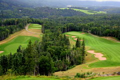 Scenic view of golf course. View of golf course in Humber Valley, Newfoundland with fog in distant valley Royalty Free Stock Photos