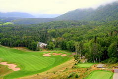 Scenic view of golf course. View of golf course in Humber Valley, Newfoundland with fog in distant valley Royalty Free Stock Photo