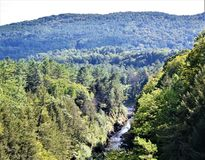 Quechee Gorge, Quechee Village, Town of Hartford, Windsor County, Vermont, United States. Scenic view of gorge and mountains from Quechee Gorge Bridge on a hazy stock photo