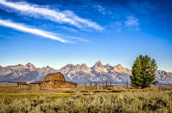 Scenic view of Grand Teton mountain range and abandoned barn Stock Photo