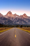 Scenic view of Grand Teton mountain range and road Stock Photos
