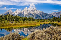 Scenic view of Grand Teton mountains  with water reflection Stock Image