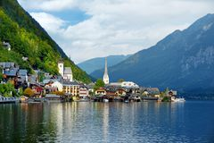 Scenic view of Hallstatt lakeside town in the Austrian Alps on beautiful day in autumn. Hallstatt, situated on Hallstatter See, a. Scenic view of Hallstatt Stock Photo
