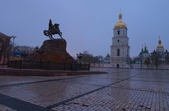 Scenic view on Hetman Bohdan Khmelnitsky monument and Saint Sophia`s Cathedral on Sofia Square, Kyiv, Ukraine. Early autumn morning, after rain. Selective Stock Image