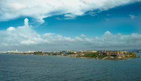 Scenic view of historic colorful Puerto Rico city in distance with fort in foreground. San juan Stock Images