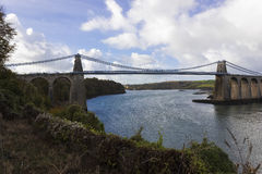 Scenic view of the historic Menai Suspension Bridge spanning the Menai Strait, Isle of Anglesey, North Wales Royalty Free Stock Photo