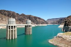 Scenic view of the Hoover Dam and intake towers. Scenic view of the Hoover Dam on the Colorado River at Black Canyon and the intake towers Royalty Free Stock Images