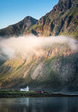 Scenic view with idyllic house and mountains. At summer evening in Lofoten, Norway Royalty Free Stock Photos