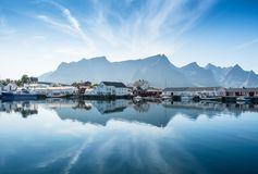Scenic view from idyllic village with mountains at bright summer day. In Hamnoy, Lofoten, Norway Royalty Free Stock Image