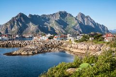 Scenic view from idyllic village with mountains at bright summer day. In Henningsvaer, Lofoten, Norway Royalty Free Stock Images