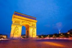 Illuminated Arc de Triomphe at night, Paris Stock Image