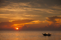 Scenic view at Indian ocean at Sri Lanka with fishman in boat Stock Photos