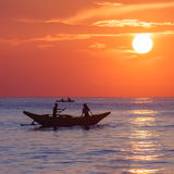 Scenic view at Indian ocean at Sri Lanka with fishman in boat Stock Image