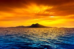 Scenic view of island. During sunset Royalty Free Stock Photo