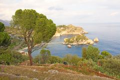 Scenic View of Isola Bella Peninsula in Taormina Town. The island of Sicily, Italy. View of the Sea.  stock photo