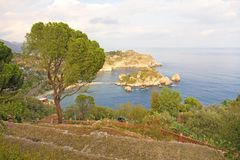 Scenic View of Isola Bella Peninsula in Taormina Town. The island of Sicily, Italy. View of the Sea.  royalty free stock images