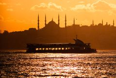 Scenic view of Istanbul at the sunset. Middle East, mosque, minarets, silhouettes, Marmara sea, ferry, orient, oriental, landscape Stock Photos