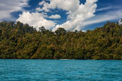Ko Chuek island, with palm trees and turquoise water under a blue sky with clouds. Ko Lanta, Thailand. Scenic view of Ko Chuek island, with palm trees and Royalty Free Stock Photos