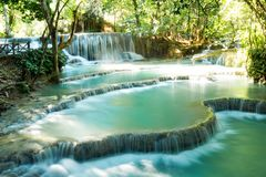 Scenic view on Kuang Si waterfall with turquoise water on a sunny day. Luangprabang, Laos Royalty Free Stock Photos