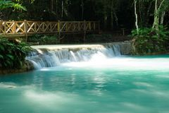 Scenic view on Kuang Si waterfall with turquoise water on a sunny day. Luangprabang, Laos Royalty Free Stock Photography