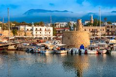 Scenic view of Kyrenia Girne harbour with mountains on backgro. Und. Cyprus Royalty Free Stock Photo