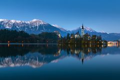 Bled lake at winter night with reflection stock images
