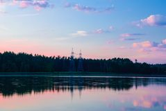 Scenic view of the lake with forest at sunset stock photography
