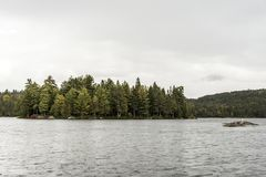 Scenic view of lake and pine tree islands with birds on them in Algonquin provincial national park Ontario Canada. Scenic view of a lake and pine tree islands Stock Photography