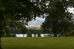 Scenic view of lake shore and hydroplane in Loch Lomond Royalty Free Stock Images