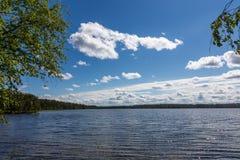 Scenic view of Lake Tulmozero under a blue sky with clouds, Karelia. Russia stock photo