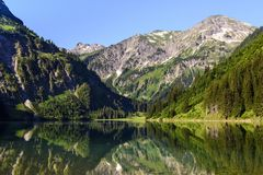 Scenic view Of Lake Vilsalpsee and mountains against sky, Tannheimer Valley, Tyrol, Austria. Europe Stock Images