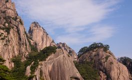 Scenic view of landscape with rocks covered by pine tree forest. Huangshan Yellow Mountains. Royalty Free Stock Images