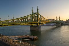 Scenic view of Liberty Bridge at Budapest. Scenic view of Szabadsag hid - Liberty bridge - at Budapest, Hungary at sunrise royalty free stock images