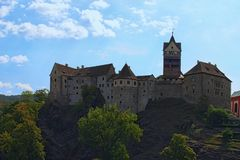 Scenic view of Loket Castle at the top of the rocky hill by summer sunny day. Bohemia, Sokolov, Karlovarsky Region, Czech Republic royalty free stock image